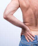 Middle-aged man with severe pain in the lumbar region Stock Photography