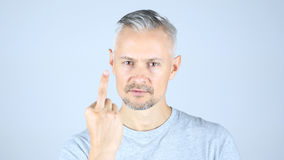 Middle Aged Man Showing Fuck You Royalty Free Stock Images