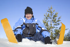 Middle-aged man sitting in snow Stock Photography