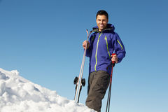 Middle Aged Man On Ski Holiday In Mountains Royalty Free Stock Photos