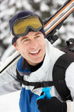 Middle Aged Man On Ski Holiday In Mountains Stock Images