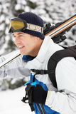 Middle Aged Man On Ski Holiday In Mountains Stock Photo