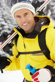 Middle Aged Man On Ski Holiday In Mountains Stock Photography