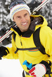 Middle Aged Man On Ski Holiday In Mountains Stock Image