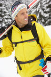 Middle Aged Man On Ski Holiday In Mountains Royalty Free Stock Images