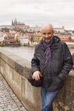 Middle-aged man smiling on the Charles Bridge Royalty Free Stock Images
