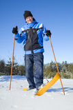 Middle-aged man smiling on skis. Finnish countryside Stock Photos