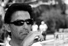 Middle aged man smoking Stock Images