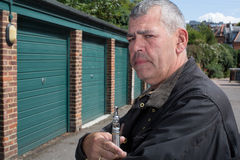 Middle-aged man smoking an e-cigarette Stock Photography