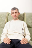 Middle-aged man on sofa Royalty Free Stock Photos