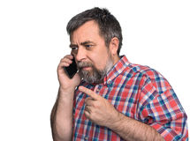 Middle-aged man speaks on a mobile phone. Isolated on white Stock Images