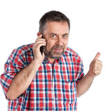 Middle-aged man speaks on a mobile phone Stock Images