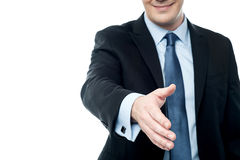 Middle aged man stretching out his hand for shaking Stock Photography