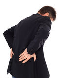 Middle-aged man suffers from backache. All on white background Royalty Free Stock Image