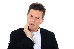Middle aged man suffers from toothache Stock Images