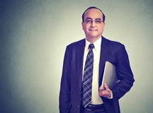 Mature business man with computer royalty free stock photo
