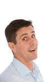 Middle-aged man with a surprised expression. Standing sideways and turning to look at the camera with wide eyes and an open mouth, isolated on white Royalty Free Stock Images