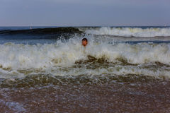 Middle-aged man swim in the ocean Stock Images