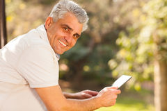 Middle aged man tablet Stock Image