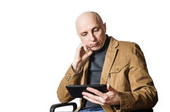 Middle-aged man with the tablet in his hands Stock Images