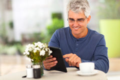 Middle aged man tablet Royalty Free Stock Images