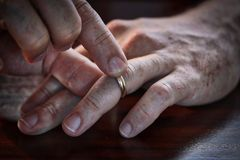 Middle Aged Man Taking His Wedding Ring Off Stock Photography
