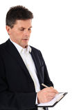 Middle aged man taking minutes Stock Photography
