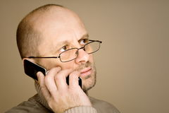 Middle aged man talking on the phone Royalty Free Stock Images