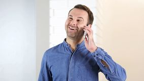 Middle Aged Man Talking on Phone, Office. High quality Royalty Free Stock Photos