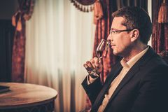 Middle-aged man tasting cognac Royalty Free Stock Photography
