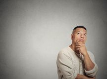 Middle aged man thinking looking up Royalty Free Stock Photo