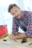 Middle-aged man with tools working on home improvement Royalty Free Stock Photo