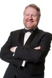 Middle aged man in tuxedo on white Royalty Free Stock Photos