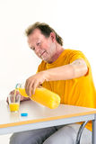Middle-aged man using a bionic prosthetic hand Royalty Free Stock Photos