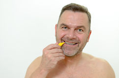 Middle aged man using interdental brush Royalty Free Stock Image