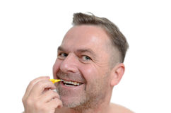 Middle aged man using interdental brush Royalty Free Stock Images