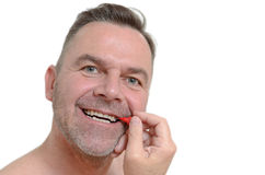Middle aged man using interdental brush Stock Image
