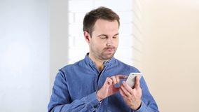 Middle Aged Man Using Internet on Phone Stock Photos