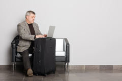 Middle aged man using a laptop. Stock Images