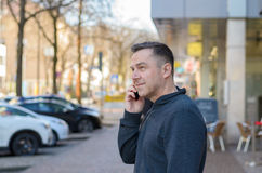 Middle aged man using mobile in city Royalty Free Stock Image