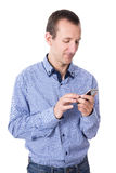 Middle aged man using smart phone isolated on white Royalty Free Stock Images