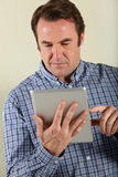 Middle Aged Man Using Tablet Computer Stock Photos
