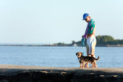 Middle Aged Man Walking His Dog Stock Photo