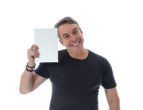 Middle-aged man wears black t-shirt. He holds the sign next to h Stock Images