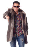 Middle aged man with winter clothing makes negative gesture Royalty Free Stock Image
