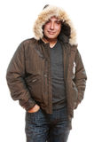 Middle aged man in winter coat. Portrait of middle aged man in winter coat over white background Royalty Free Stock Photography