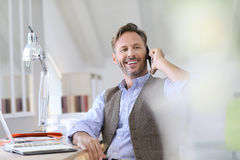 Middle-aged man at work talking on the phone Stock Photography