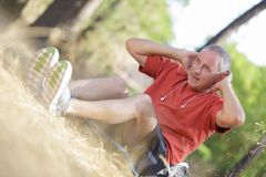 Middle-aged man working out outside. Middle Stock Image