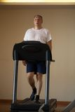 Middle-aged man working out on a treadmill Royalty Free Stock Photo