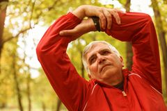Senior man exercising in the park. royalty free stock images